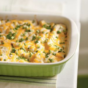 Trade the traditional enchilada sauce for a creamy, cheesy topping on this Mexican chickencasserole recipe. Your family will never know they're enjoying a lightened meal.