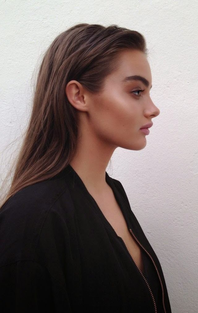 Apply bronzer to the cheekbones and eyelids for a dewy glow