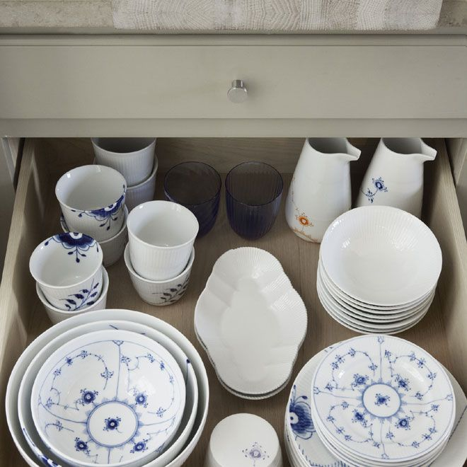 Drawer stacked with mix of porcelain in the 2012 Royal Copenhagen Catalogue