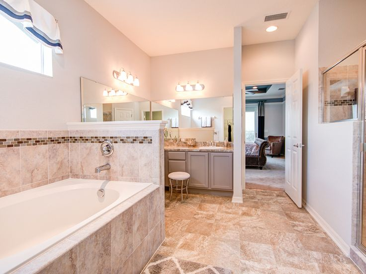 Pictures In Gallery This spa like master bathroom uses warm neutral tones to create a relaxing oasis