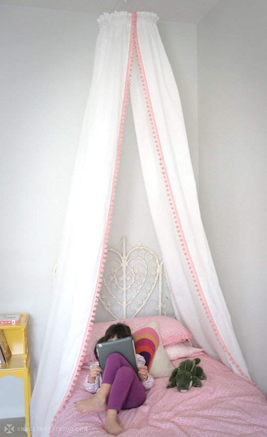 small shop: DIY bed tent pom pom canopy, John Robshaw bedding, Jonathan Adler pillow, vintage wicker headboard