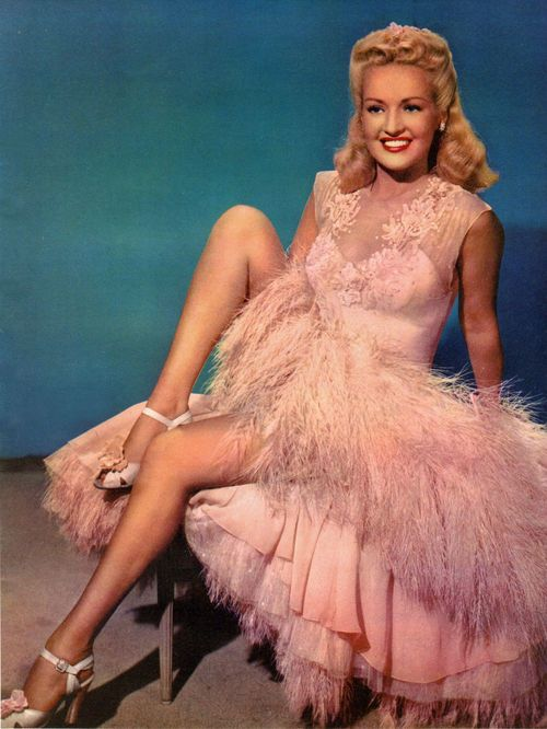 Betty Grable 1953 ...from back when leading ladies were real women who smiled like they just ate the last guy who looked at them that way...
