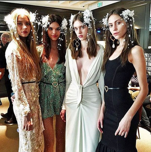 Alessandra Rich's (@alessandrarich) romantic escapades, expanses of lace, frilled, fluted hems, large poufy sleeves worn off the shoulder and trenchcoats in silk moire, she calls this 'Dolores,' the story of a girl who runs away to get married. Definitely falling in this kind of love! #PFW