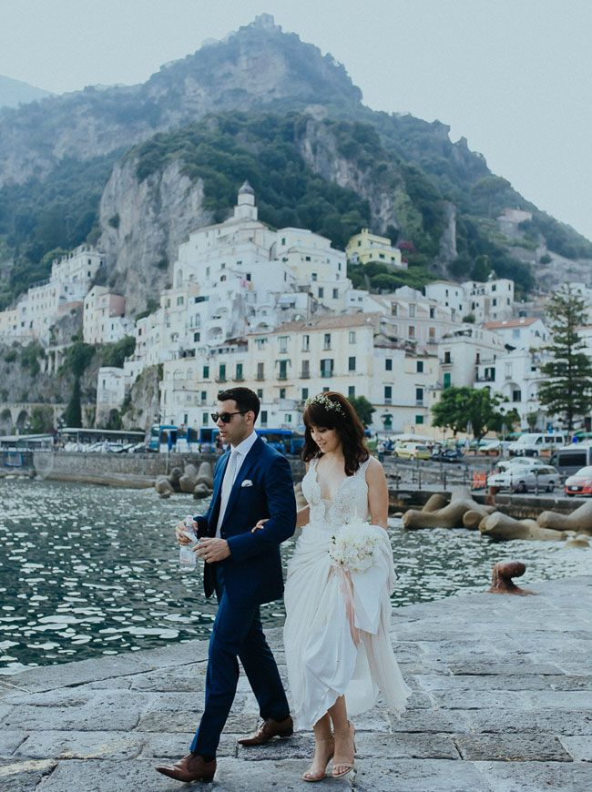 Italian jewel - Amalfi Coast is filled with pretty buildings and turquoise waters. A dream honeymoon + destination wedding.