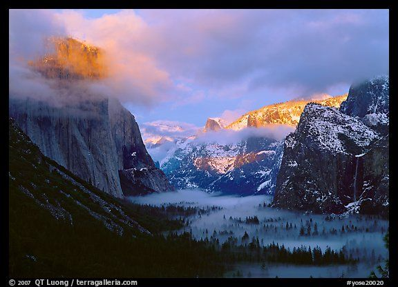 View with fog in valley and peaks lighted by sunset, winter. Yosemite National Park, California, USA