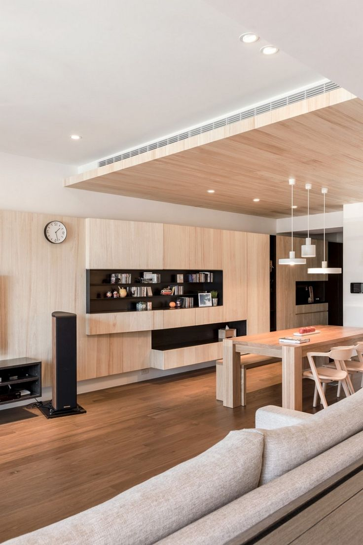 Apartment: Built In Shelving Mixed With Solid Wooden Dining Set Beneath Stylish Pendant Lamp On Wooden Ceiling Mixed With Fabric Sofas Also Laminated Wooden Floor: A Modern Apartment Celebrates the Look of Natural Wood