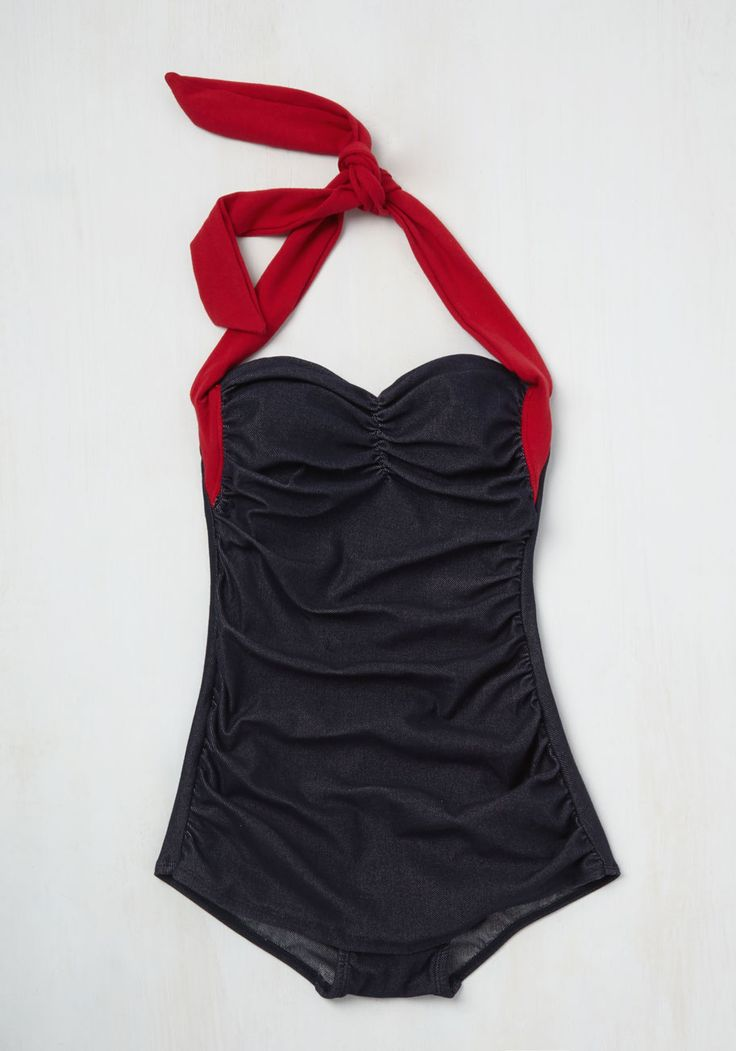 There's nothing better than being beach-bound in this two-toned swimsuit by Girlhowdy! Its red halter ties dance in the highway breeze, while a center-cinched neckline and side-ruched, skirted accents keep this denim-inspired swimsuit looking so flattering, you'll make a splash in a snap!