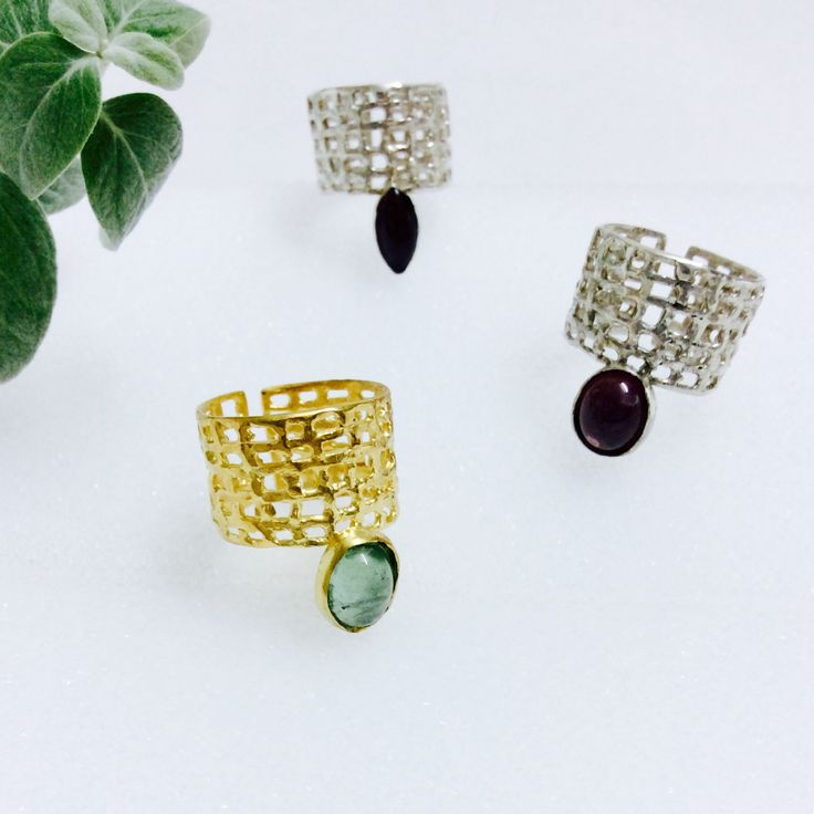 The net rings with tourmaline and grenade stone, made of silver