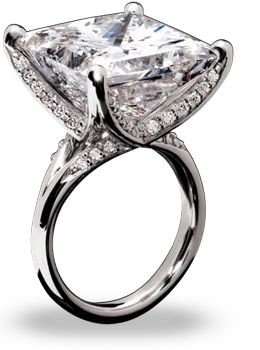 stunning 22.25 carat princess cut diamond is set in platinum with a half-round shank that forms four claws, securing the diamond in a prong setting. The platinum shank is encrusted with graduating diamonds totaling an additional 0.60 carats.