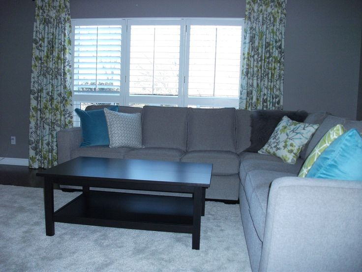 Another custom made sectional (Homesource in Markham, Ontario, Canada), and custom feather cushions, with two pleat linen curtains...love this room!