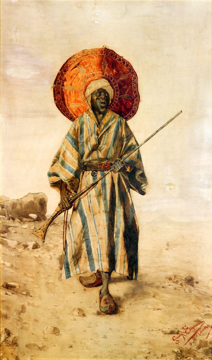GIUSEPPE SIGNORINI (1857-1932)  ORIENTAL AU FUSIL, Shown wearing a carnelian belt (jakicar) and holding a musket.