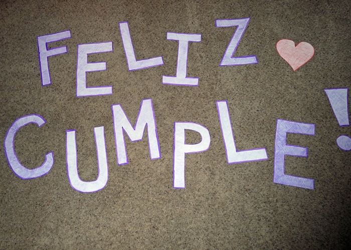 Creative birthday gift ideas for a long-distance boyfriend; I cut out the letters for 'Feliz Cumple' (happy bday in Spanish), took a goofy picture with each and mashed them together into a slideshow, using Slide.ly.