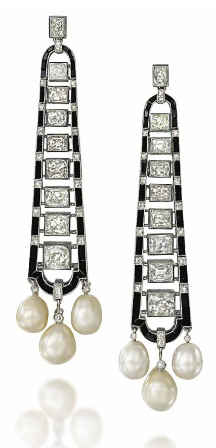A PAIR OF ART DECO ONYX, NATURAL PEARL AND DIAMOND EAR PENDANTS.  Of tapering form, the graduated row of old-cut cushion shaped diamonds within a calibré onyx and diamond point border suspending a three pearl tassel termination, circa 1925, 7.8cm long, post fittings Accompanied by report no.07706 dated 3 May 2013 from The Gem & Pearl Laboratory, London, stating the pearls are natural, saltwater