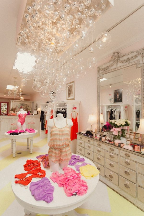 A sweet lingerie shop - chevron floor, bubble chandelier.  Faire Frou Frou.