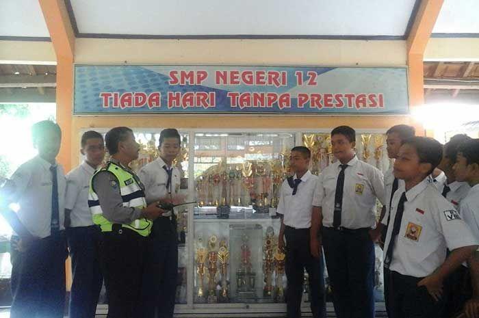 Tribratanewsmagelangkota.com – Bhabinkamtibmas Tidar Selatan Magelang Kota Jawa Tengah Ajun Inspektur Polisi Satu Slamet Paryoto menghadiri