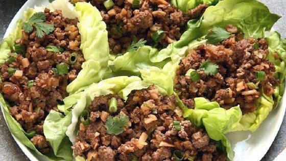 Tangy marinated beef is wrapped in refreshing lettuce leaves in this quick and easy Asian lettuce wrap recipe.
