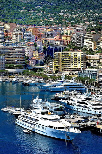 Yachts in Monte Carlo Harbor - ASPEN CREEK TRAVEL - karen@aspencreektravel.com    In Riviera Rendezvous, Amalie and Xandros board a private yacht in Monaco for a wedding party.
