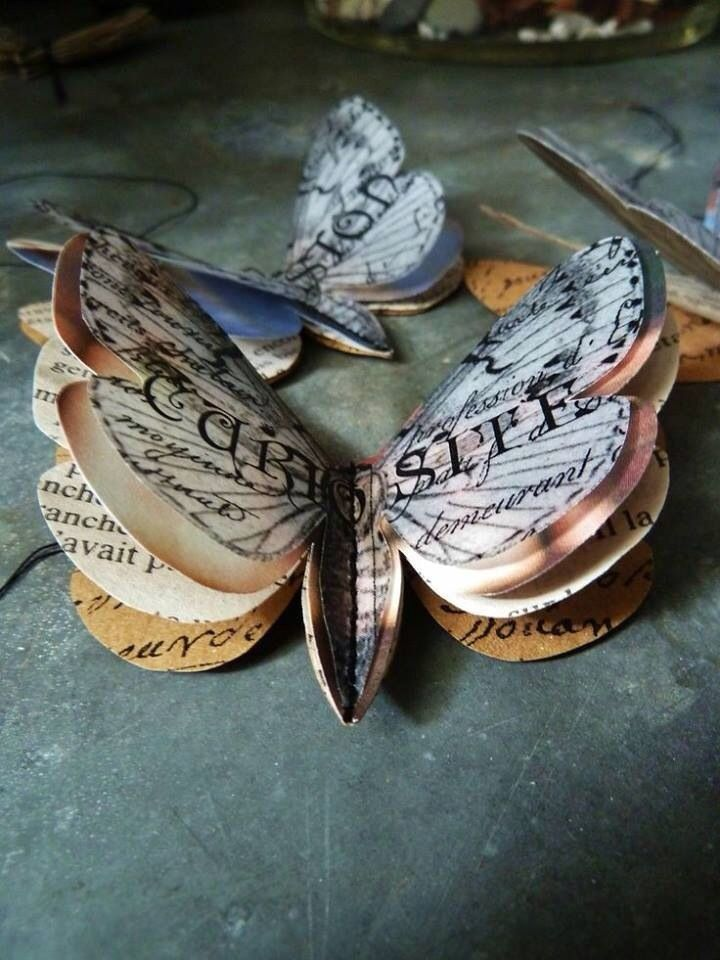 Butterflies made from old books etc. No tutorial.