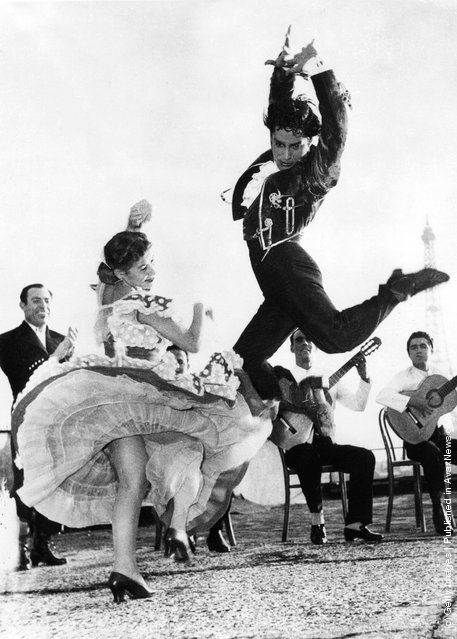Spanish flamenco dancers Rosario and Antonio rehearse on the terrace of the Champs Elysees Theatre in Paris before a show, 26th September 1951