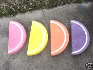 candy fruit slices...foam rounds, painted and glitter spray?