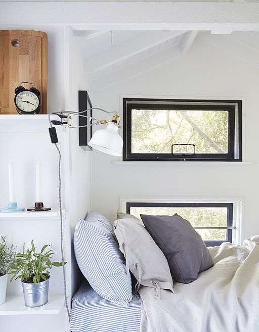 Squeeze in multipurpose solutions - switch pillows for cushions to use a bed as seating, and keep lighting flexible by using clamp spotlights. They don't take up any extra floor or surface space and can be directed where a little more brightness is needed – especially for bedtime reading #IKEAIDEAS