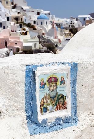 Religious art on balcony overlooking houses. Saint Nicholas