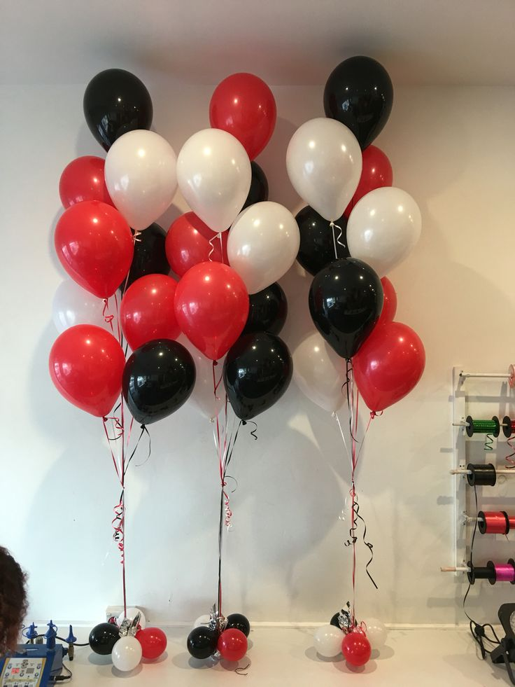 Bunches of black, red, white helium balloons in foyer (top and bottom) have one full helium canister..prob need another too!