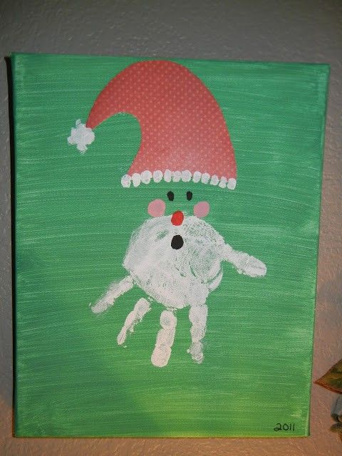 Canvas hand print hat-wearing Santa arts for kids for 2014 Christmas - 2014 Christmas home decorations, Christmas Decor Ideas.