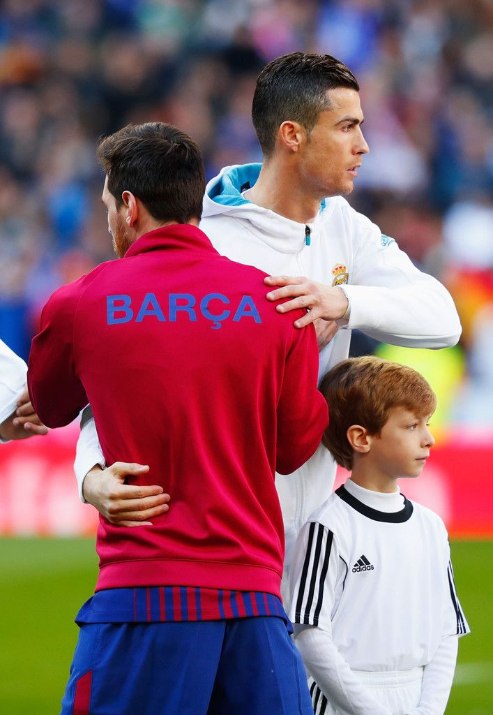 Cristiano Ronaldo Photos - Cristiano Ronaldo of Real Madrid greets Lionel Messi of Barcelona prior to the La Liga match between Real Madrid and Barcelona at Estadio Santiago Bernabeu on December 23, 2017 in Madrid, Spain. - Real Madrid v Barcelona - La Liga