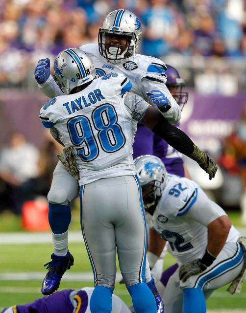 Lions vs. Vikings:  22-16, Lions  -  November 6, 2016  -    Detroit Lions defensive end Kerry Hyder, top, celebrates with teammate Devin Taylor (98) after making a tackle during the first half of an NFL football game against the Minnesota Vikings, Sunday, Nov. 6, 2016, in Minneapolis.