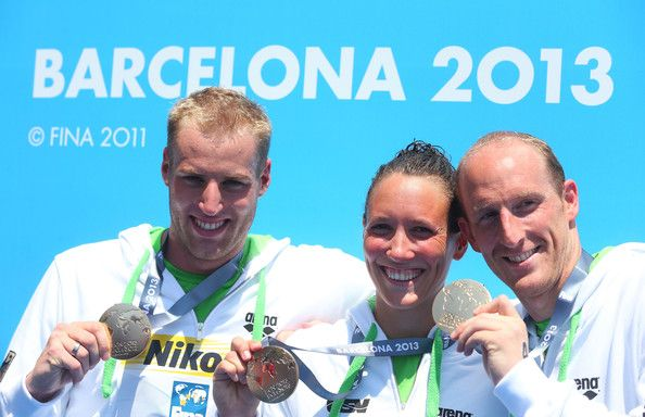 Thomas Peter Lurz, Christian Martin Reichert and Isabelle Franziska Harle of Germany, Gold medalists, pose after winning the Open Water Swimming Team 5k race on day six of the 15th FINA World Championships at Moll de la Fusta on July 25, 2013 in Barcelona, Spain.