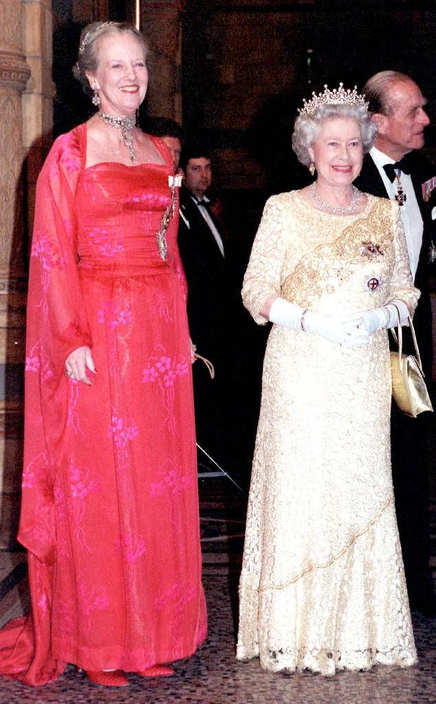 Queen Elizabeth II—in a cream-lace gown—and Queen Margrethe of Denmark greeted guests at a reception in London's Natural History Museum.