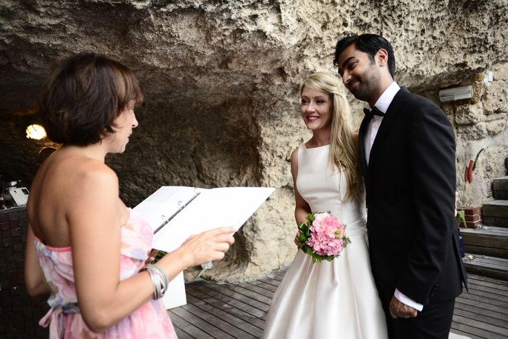 """Couple says"""" I Do"""" in the Apulian Cave. Intimate outdoor wedding ceremony."""