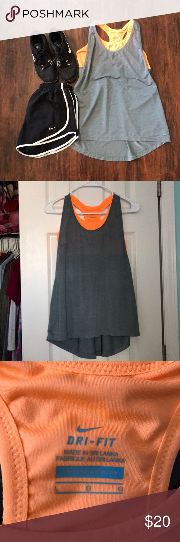 BOGO 1/2 OFF Nike sports bra tank top Grey dri-fit tank top with neon orange built-in sports bra, gently used, great condition ✨make an offer!✨ feel free to comment if you have any questions😊 ‼️ALL LISTINGS BUY ONE GET ONE HALF OFF❗️(of the two items, the less expensive item will be half off) just make a bundle and I'll re-price‼️ Nike Tops Tank Tops