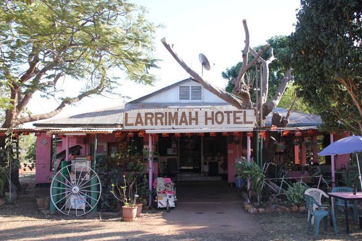 Larrimah Wayside Inn A pink pub in the middle of Australia's Outback? Yep, that's the Larrimah Wayside Inn, located between Mataranka and Daly Waters on the Stuart highway. Keep an eye out for the giant Beer bottle out the front – perfect for a photo that will make all of your mates jealous of your Outback pub adventure. Photo: Larrimah Wayside Inn