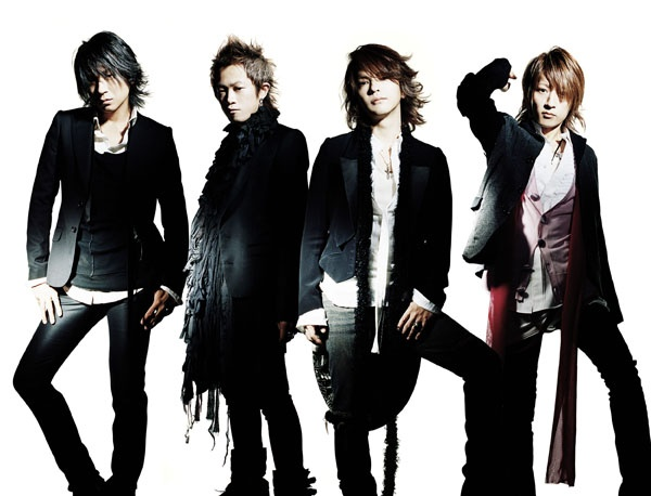L'Arc en ciel  20th anniversary celebration.  March 25, 2012 at Madison Square Garden.  from right to left Tetsuya Guitar bassist, Hyde (Haido) vocal, Yukihiro drummer, and Ken Guitar.  Great lyrics, rifts, and vocal!