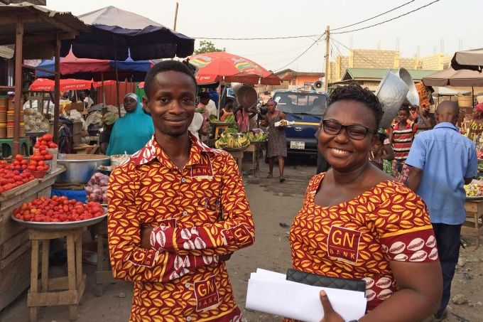 Mobile bankers stop along their customer route at Madina Market in Greater Accra, Ghana. Photo credit: Kate Murphy/Open Society Foundations