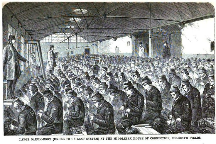 Prisoners picking oakum at Coldbath Fields Prison in London (ca. 1864).