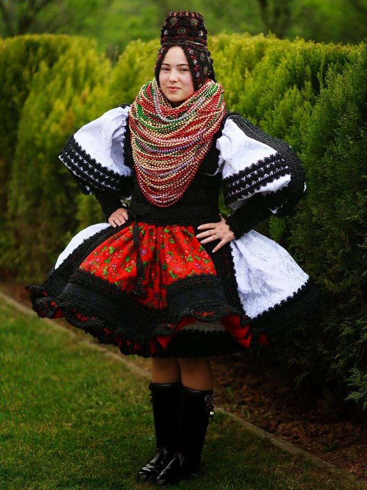 -Europe | Portrait of a Romanian woman wearing a traditional dress and crown, Racsa, Negresti-Oas, Romania | Alexandru Feher