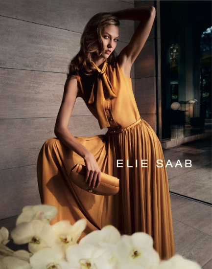 Sunshine orange flowy dress with loose neck bow. Belted, matching clutch (Elie Saab)