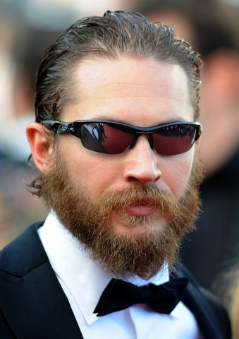 """Tom Hardy talks about the rain in Cannes:        Lawless star Tom Hardy, who stars as the villain Bain in the upcoming Batman movie, was pretty sure who was to blame.        """"I brought it with me,"""" he laughed. """"Wherever I go I bring the rain.""""        But it wasn't stopping him.        """"I can give a (expletive) about rain,"""" he said. """"I'm from London. We invented it."""""""