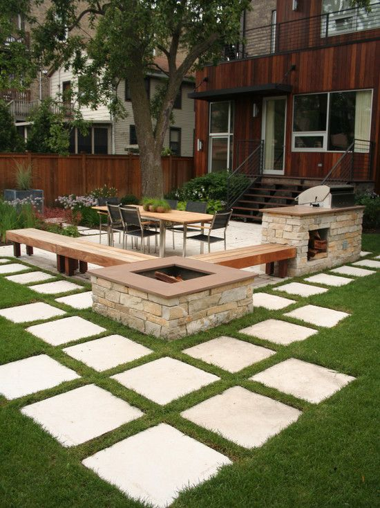 Simple and Elegant Outdoor Seating Area with Fire Pit and Grill. Natural Stone Thin Veneer on face of Fire Pit and Grill.