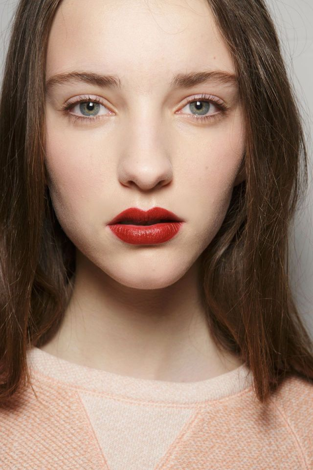 Red lipstick doesn't sound all that revolutionary, but when it goes away for a few seasons in favor of clear balms and nude tints, then makes its comeback in big, not-so-expected ways on the fall runways, well, it's what we needed to get us excited about the makeup bag staple all over again. At 3.1 Philip Lim (left), makeup artist Francelle Daly looked to her '90s-era Doc Martens to inspire the brick-red shade, while Dolce & Gabbana and Marchesa went moodier than usual with their takes on…