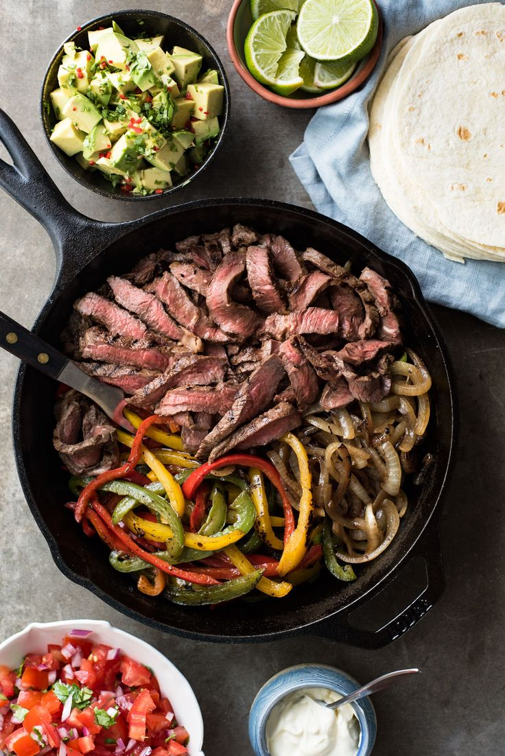 Beef fajitas made extra juicy and extra tasty with a wicked marinade that's so easy! A faster recipe that requires NO marinating time is also included.