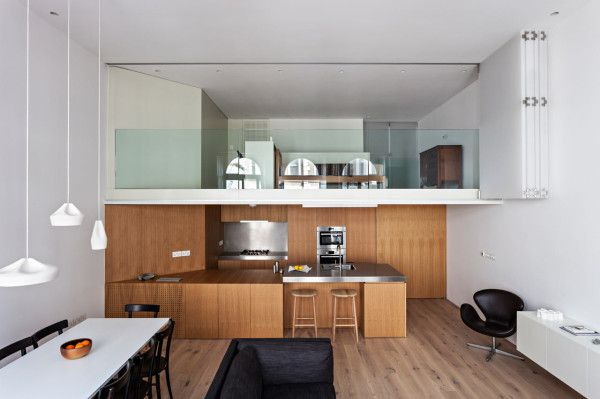 This apartment has a study that looks out into the open space.