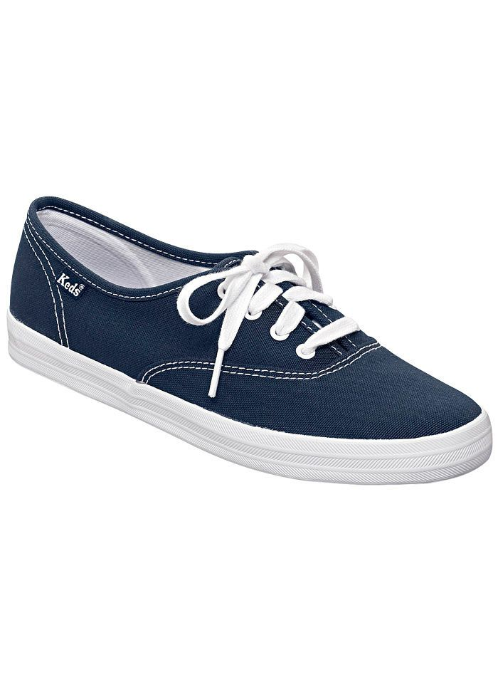 navy blue and white keds