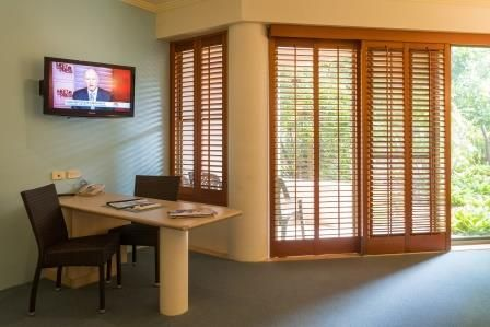 Quality Hotel Ballina's King Spa room with patio.