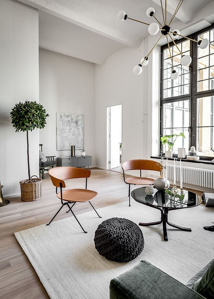 European loft living - amazing high ceilings and industrial style windows