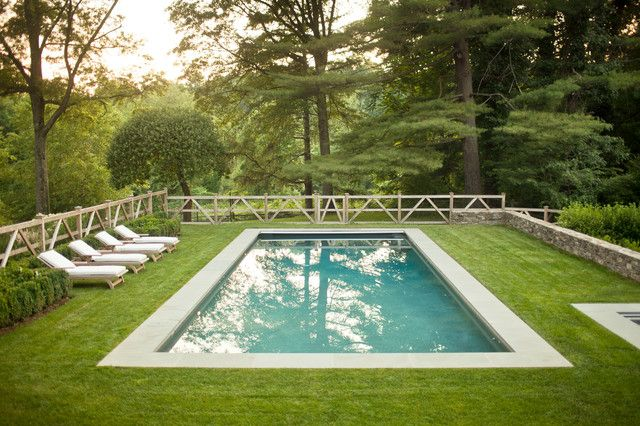 removable pool fence Pool Farmhouse with chaise lounge forest grass lawn rectilinear pool split rail