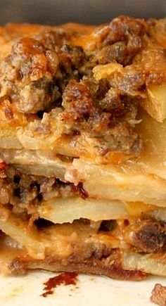 Meat and Potato Casserole ~ The potatoes are soft, the top is slightly crispy with the meat, cheese, and potatoes peaking out from the bubbly and creamy sauce.